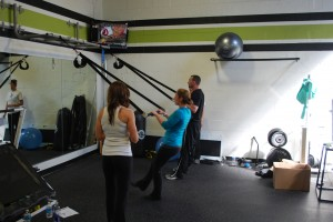 Fitness Plus personal trainers Katie and Dave work out with SO-50 equipment