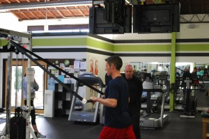 Rob Sweet, a personal trainer at Fitness Plus in Lexington KY, is working the Strong Over 50 equipment with SO-50 founder John Stuef