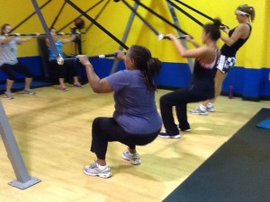 Rapid Fitness clients practice squats on Strong Over 50 equipment