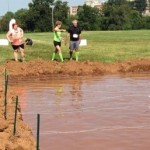 FP trainer Laura Coombs and client Steve MacNeil approaching the mud pit. Extreme Rampage 2013.