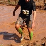 FP client Steve MacNeil makes it through the mud. Extreme Rampage 2013 at Masterson Station Park in Lexington.