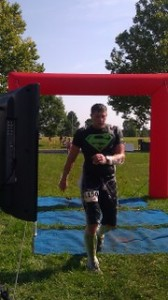 """Fitness Plus trainer Joey """"Superman"""" Hacker at the finish line. Extreme Rampage 2013."""