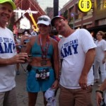 A happy Ironman with her family. Amy Ball flanked by brother Andy (left) and husband Charlie.