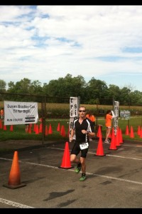 Shane Burry crossing the finish line at the 2014 Tri for Sight triathlon
